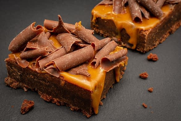 Chocolate Brownies with salted caramel sauce and chocolate flakes